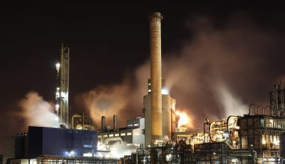 brown-and-white-factory-building-during-night-time-3855962